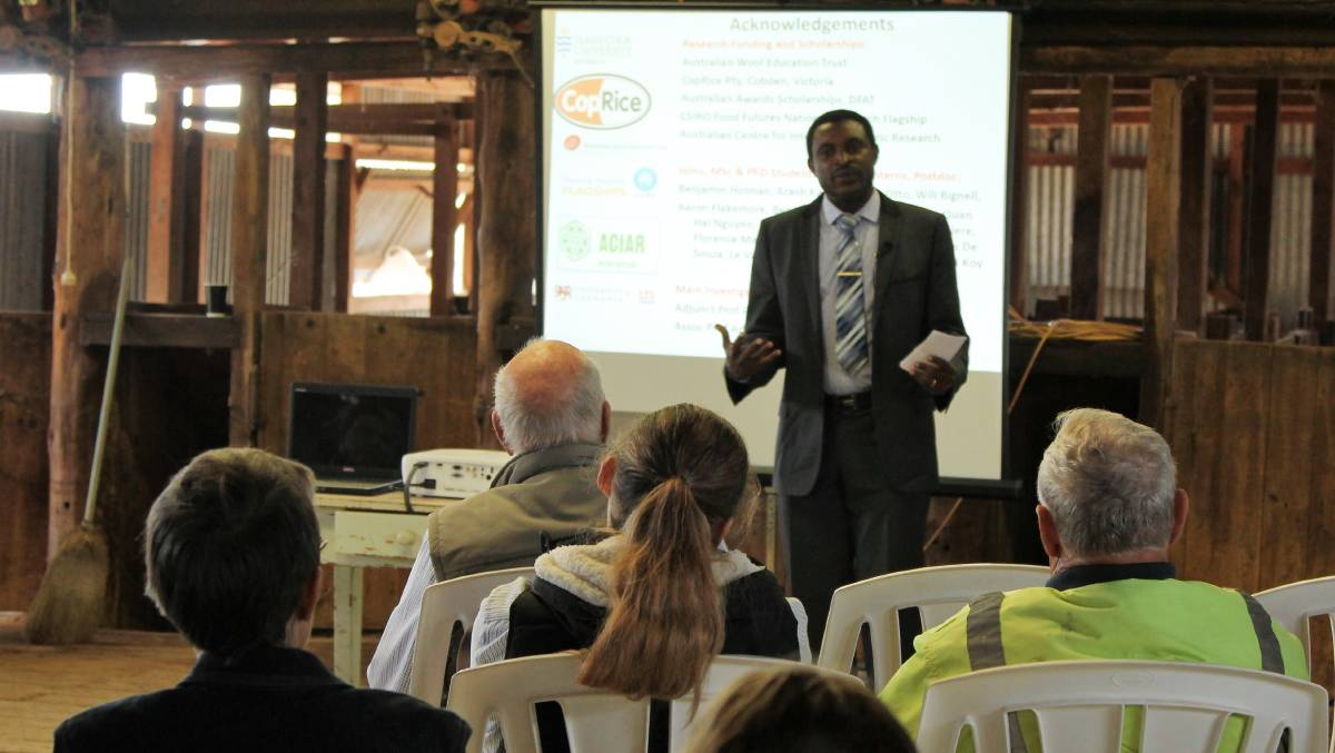 Aduli Malau shares his findings with the audience at Cunnamulla.